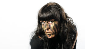 Headshot of darkhaired girl with facepaint streaks Royalty Free Stock Photography
