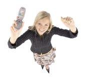 Headshot de la mujer feliz rubia joven con el teléfono moble Imagenes de archivo