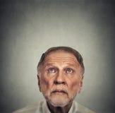 Headshot elderly man looking up Stock Images