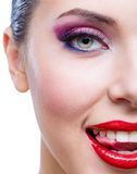 Headshot of female half-face with bright makeup Royalty Free Stock Image