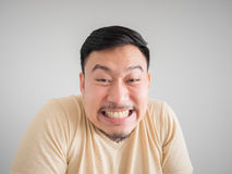 Headshot of funny guilty Asian man. Royalty Free Stock Photo
