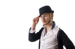 Headshot of handsome blond young man. Blue eyes wearing fedora hat, isolated on white background Royalty Free Stock Image