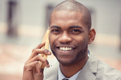 Headshot handsome happy laughing young business man talking on mobile phone Stock Image
