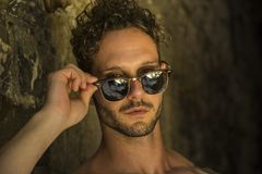 Headshot of unshaved handsome man wearing sunglasses stock images