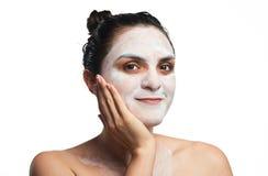 Headshot kobieta z śmietanką na twarzy Zdjęcia Stock