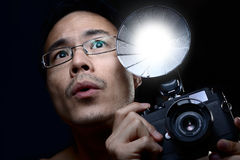 Headshot : Man looking up while holding a vintage Stock Photo