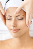 Headshot of naked woman getting face massage Royalty Free Stock Images