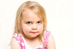 Headshot Portrait of Beautiful Toddler Girl with Mischevious Expression stock photos