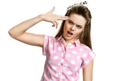 Headshot portrait of girl committing suicide touching her temple with finger gun gesture. Human emotions face expressions. Photo of young brunette woman over Royalty Free Stock Photos