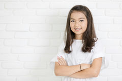 Headshot Portrait of happy cute girl smiling looking at camera. White wall background Royalty Free Stock Photos