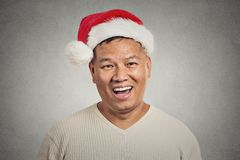 Headshot portrait of middle aged man with red santa claus hat happy smiling Stock Image