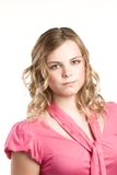 Headshot portrait of teenage girl in pink blouse Royalty Free Stock Photos
