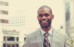 Headshot portrait of young man smiling royalty free stock photo