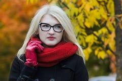 Headshot portrait of young woman wearing cat eye Stock Photo