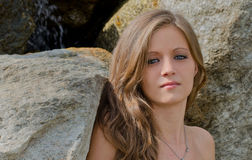 Headshot of pretty blue eyed, brunette girl outdoor Royalty Free Stock Photo