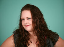 Headshot of pretty overweight girl. Close up of beautiful plus size girl stock photos