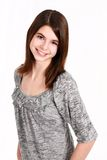 Headshot of pretty young girl. Pretty young teen girl in studio smiling Stock Photography