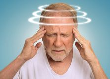 Headshot senior man with vertigo suffering from dizziness Royalty Free Stock Photos