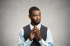 Headshot sly, scheming businessman Stock Photography