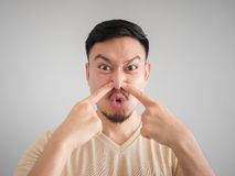 Headshot of smell something bad face of Asian man. Headshot of smell something bad face of Asian man with beard and mustache stock image
