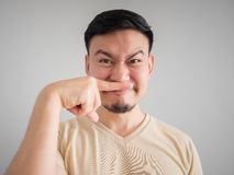 Headshot of smell something bad face of Asian man. Headshot of smell something bad face of Asian man with beard and mustache Stock Photo