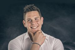 Headshot of smiling attractive young man in white Stock Photo