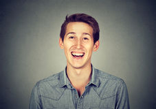 Headshot smiling laughing modern man, creative professional. On gray wall background royalty free stock photo
