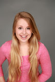 Headshot of smiling teen girl with braces. Head shot of happy teen girl with blonde hair looking at camera Royalty Free Stock Images