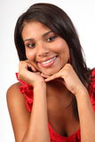 Headshot of stunning young girl beautiful smile. Headshot of stunning young girl looking happy in a relaxed pose resting chin on hands stock images