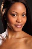 Headshot of stunningly beautiful black woman. Stunning headshot of beautiful black woman with lovely eyes and smile Royalty Free Stock Photos