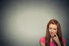 Headshot thoughtful skeptical jealous young woman Stock Photo