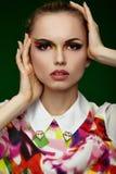Headshot van een vrouw met drievoudige kleur maakt omhoog Stock Fotografie