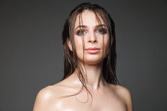 Headshot of wet-haired model with make-up Stock Photos