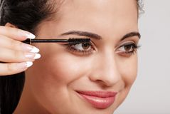 Headshot woman applying mascara Royalty Free Stock Image