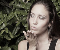 Headshot of a woman blowing a kiss Stock Image