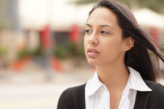 Headshot of a woman glancing away Stock Photos