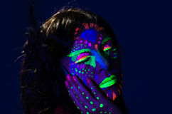 Headshot woman wearing awesome glow in dark facial Royalty Free Stock Photography