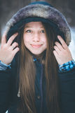 Headshot of young beautiful woman in warm clothes Royalty Free Stock Images
