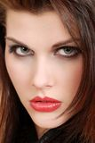 Headshot young brunette woman with red lipstick Stock Photography