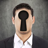 Headshot young faceless man with keyhole instead of face Royalty Free Stock Image