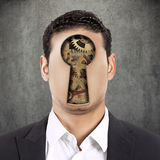 Headshot young faceless man with keyhole and gear mechanism Royalty Free Stock Photo
