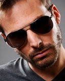 Headshot of a young man in dark glasses Royalty Free Stock Images