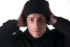 Headshot of young man with wool hat and winter coat Stock Photography