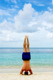 Headstand by the beach Royalty Free Stock Photos