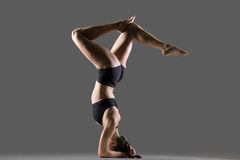 Headstand with bent legs Stock Images