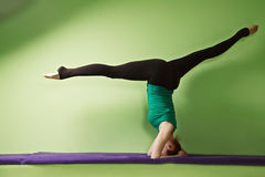Headstand with legs split Royalty Free Stock Photo