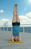 Headstand on sea background Stock Photos