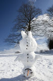 Headstand Snowman. Snowman standing on the head with tree on the leg Royalty Free Stock Photography
