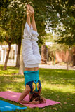 Headstand yoga pose outdoors Royalty Free Stock Image