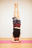 Headstand during yoga practice Royalty Free Stock Photo